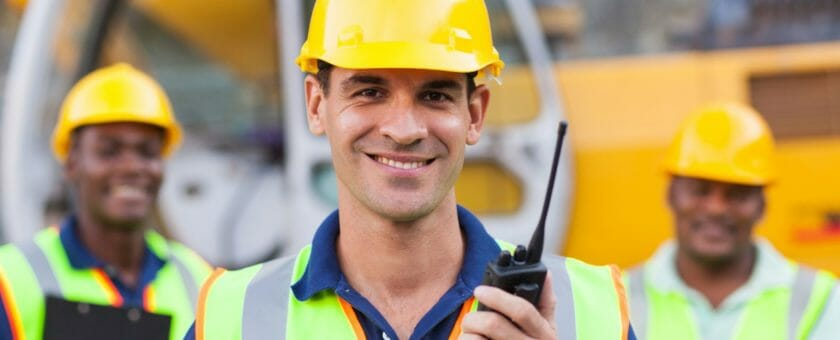 Subcontractors on building site with walkie talkies | Tradesman Saver