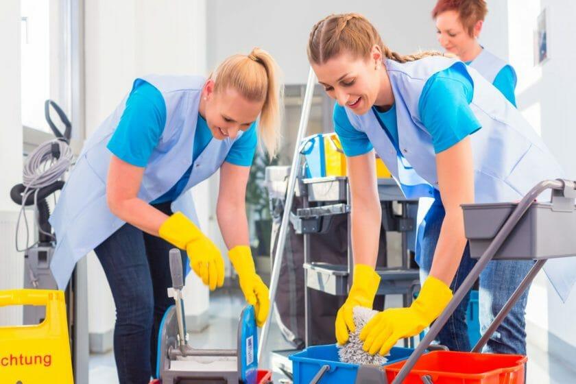 self-employed cleaners preparing buckets to mop floor