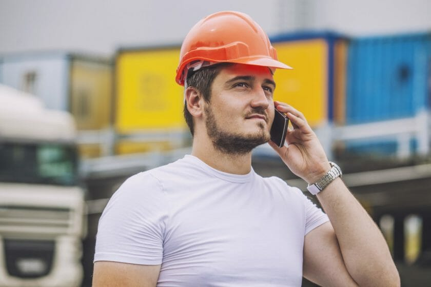 self employed tradesman on the phone to his customers telling them he will be taking some time off