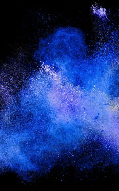 blue powder explosion on black background