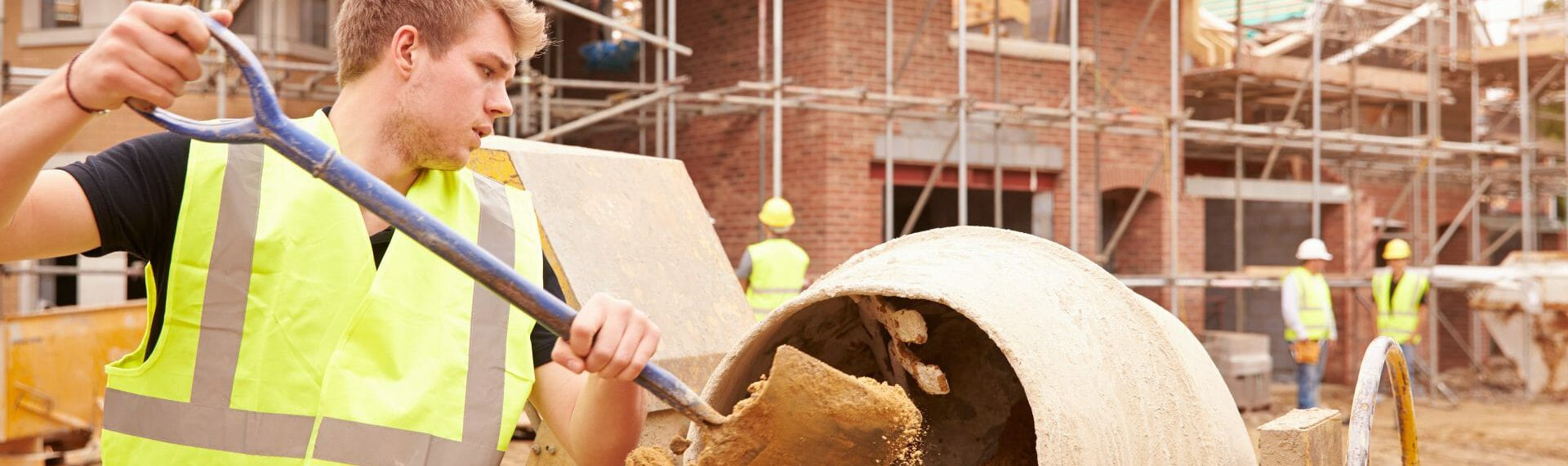 building contract using cement mixer on building site