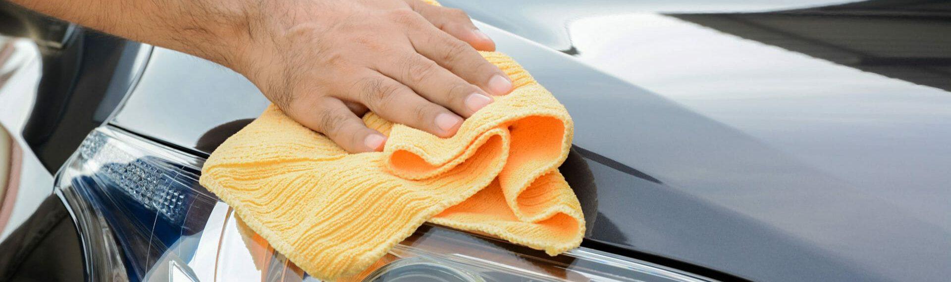 car valeter polishing car bonnet