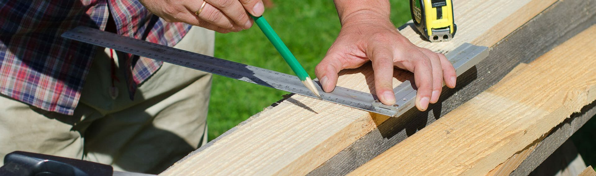 carpenter with tools marking up wood