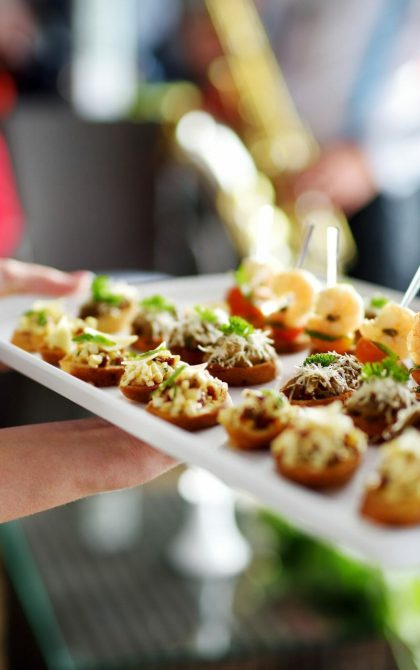 catering contractor serving canapes at an event