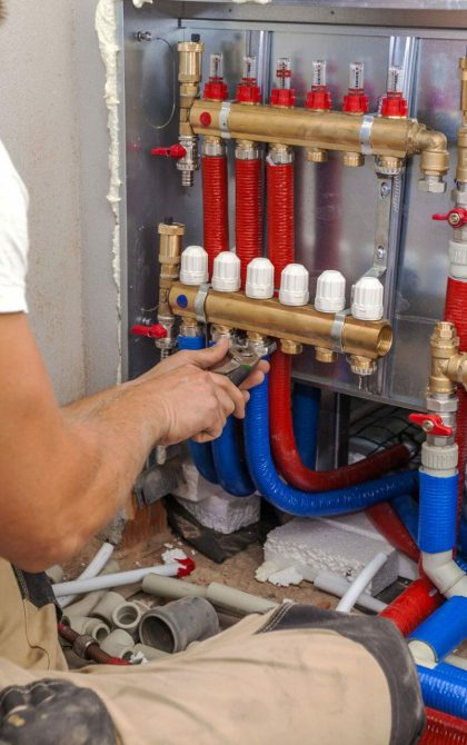 central heating system being installed by plumber