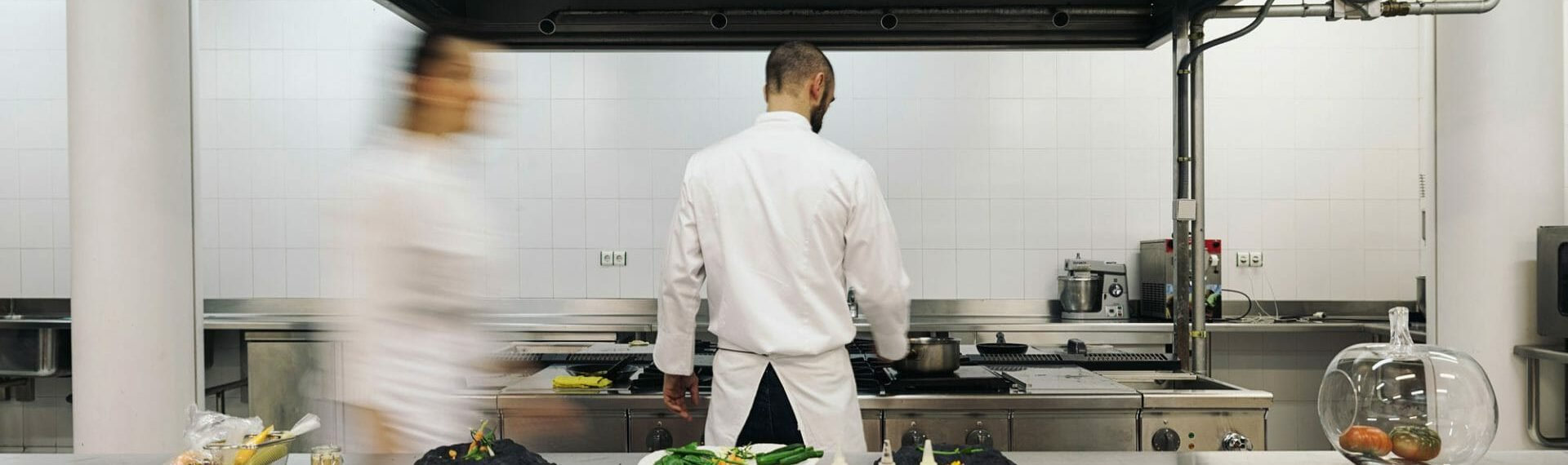 chef in whites working in a kitchen