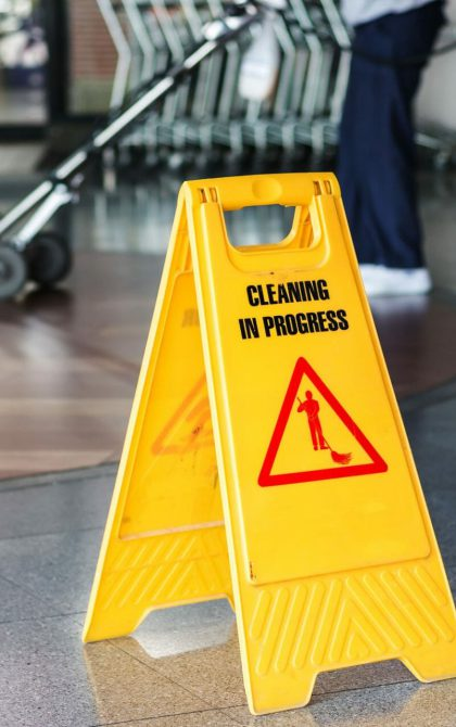 yellow commercial cleaning in progress sign