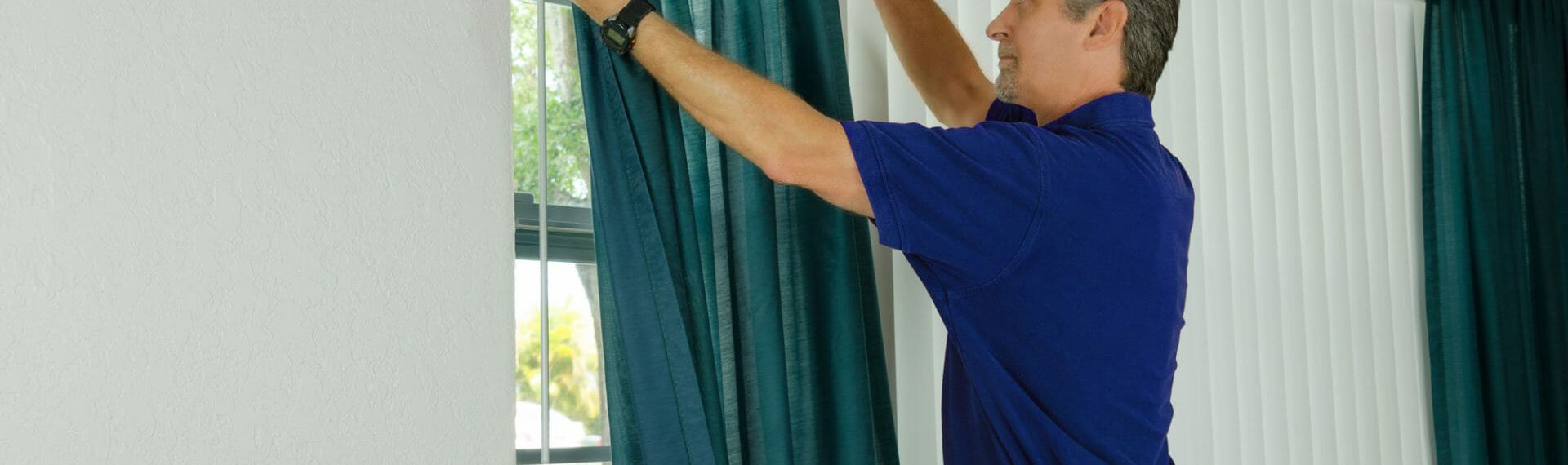 curtain fitter hanging green curtains