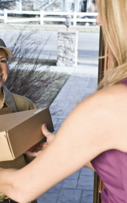 delivery driver handing parcel to customer