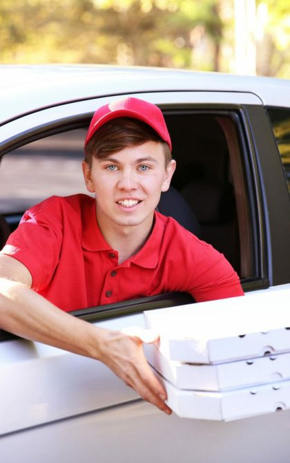 fast food pizza delivery person in car