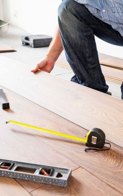 flooring contractor installing wood flooring