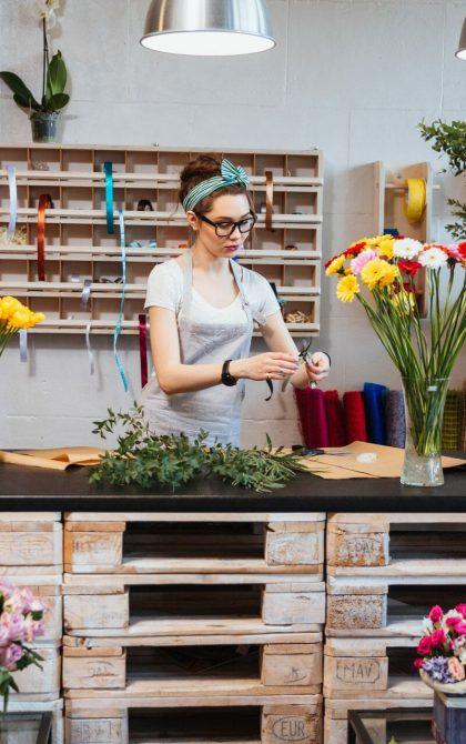 florist arranger flowers in a shop