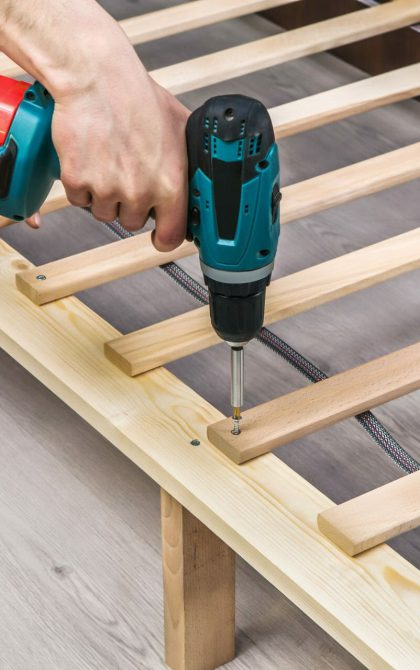 furniture being installed with electric screwdriver