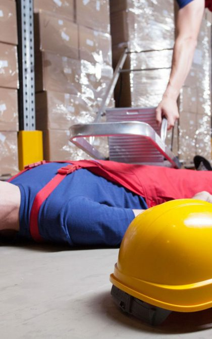 tradesman laying on fallen having fallen off a ladder