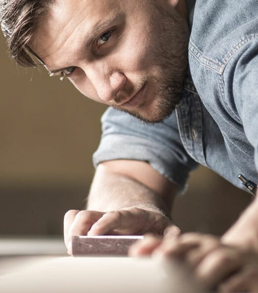carpenter sanding wood | Tradesman Saver