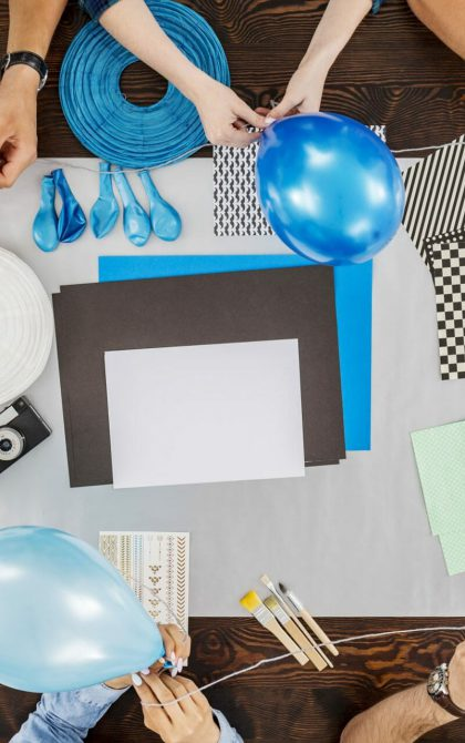 party planners blowing up balloons