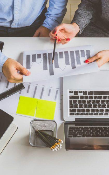professionals reviewing insurance | Tradesman Insurance
