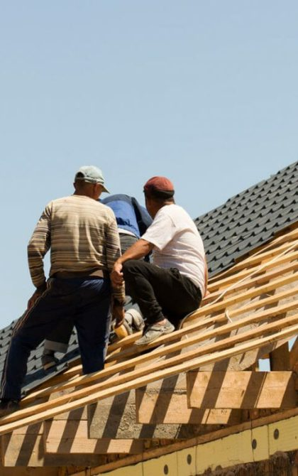 3 roofers working on the roof of a home