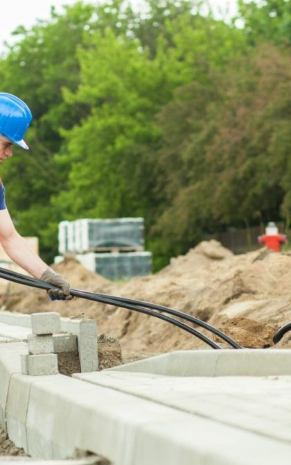 subcontractors working together on construction site | Tradesman Saver