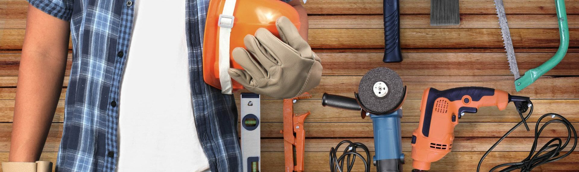 tradesman standing in front of tradesman tools and equipment