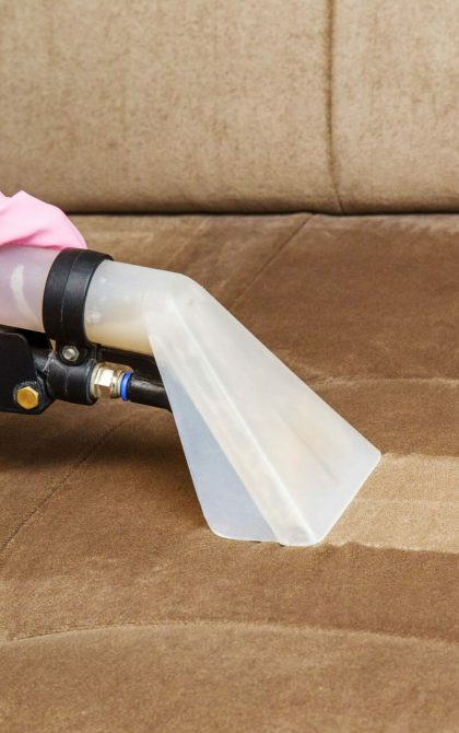upholstery cleaning machine being used on sofa